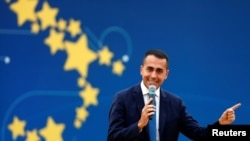 Italian Deputy PM Luigi Di Maio speaks at the 5-Star Movement party's open-air rally at Circo Massimo in Rome, Italy, Oct. 21, 2018.