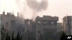 Hêzên Sûrî Gaza Rondikrêj Berda Nerazîbûyan li Homisê