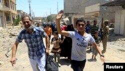 2017年5月30日,在摩蘇爾老城城北流離失所的人