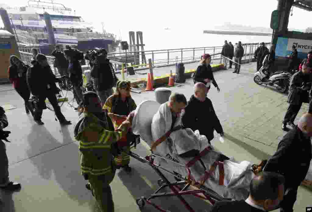 A victim of the Seastreak Wall Street ferry accident is pushed on a stretcher, January 9, 2013.