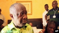 April 11: Former Ivorian President Laurent Gbagbo and his wife Simone, in the custody of forces loyal to Alassane Ouattara at the Golf Hotel in Abidjan, Ivory Coast. Forces stormed the bunker and arrested Gbagbo, whose refusal to hand over the presidency