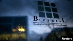 A logo is seen on a glass sign in front of the entrance of the Biotrial laboratory building in Rennes, France, Jan. 15, 2016.