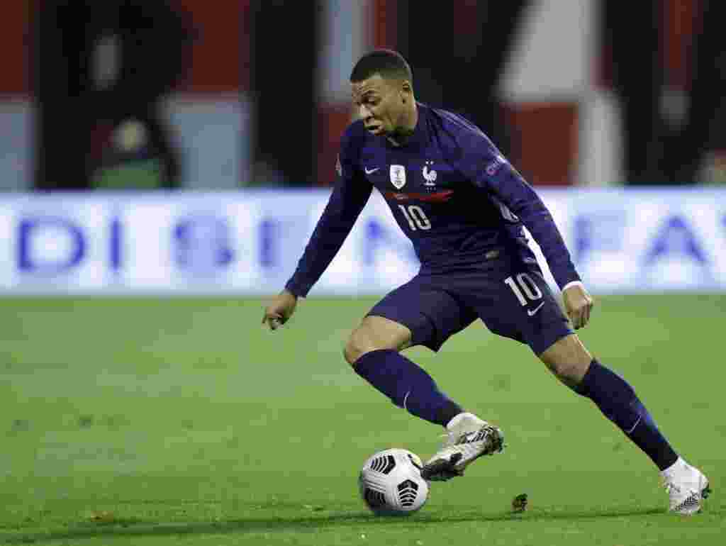 Kylian Mbappé, PSG - Forward - Striker The French Football Federation (FFF) confirmed in early September Paris Saint-Germain and France striker Kylian Mbappé tested positive for COVID-19. Mbappé marked his recovery and return to action with a goal in a 3-0 PSG win over Nice. Photo: France's Kylian Mbappe controls the ball during the UEFA Nations League soccer match between Croatia and France at Maksimir Stadium in Zagreb, Croatia, Wednesday, Oct. 14, 2020. (AP Photo/Darko Bandic)