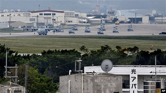 A military plane and helicopters are seen at Marine Corps Air Station Futenma in Ginowan, Okinawa, Japan (2009 File)