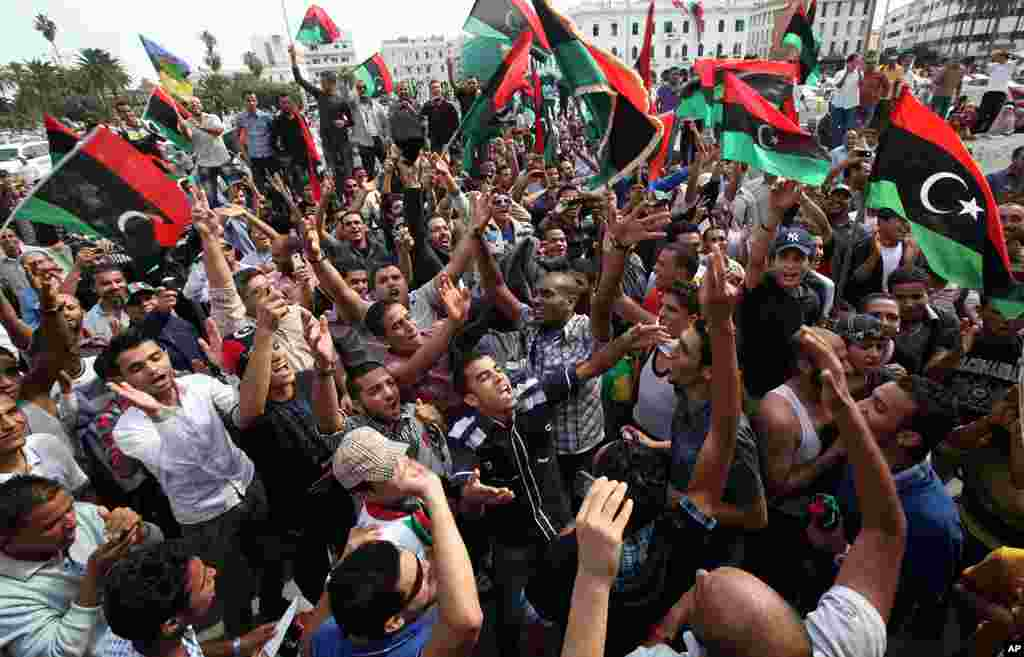 Residents celebrate at Martyrs square in Tripoli after hearing the news that Moammar Gadhafi was killed in Sirte. (Reuters)