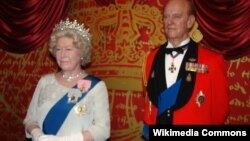 Wax statues of Queen Elizabeth II and Prince Philip at Madame Tussauds museum in London. They were made to a tee!