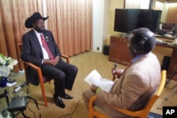 President of South Sudan Salva Kiir and VOA South Sudan in Focus host John Tanza at UN on Saturday, September 24,2011