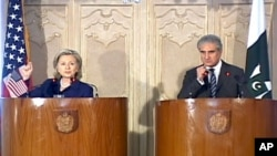 U.S. Secretary of State Hillary Clinton and Pakistan's Foreign Minister Shah Mahmood Qureshi at a joint press conference in Pakistan.