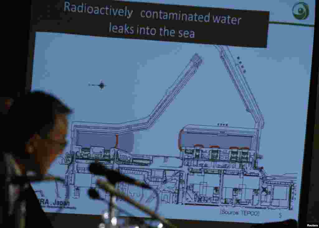 Japan's Nuclear Regulation Authority Chairman Shunichi Tanaka is seen in front of a screen showing the current situation of the contaminated water leakage at Fukushima Daiichi, Sept. 2, 2013.