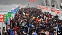 Chinese jobseekers check out the various vacancies offered at a job fair in Hefei, east China's Anhui province. Premier Wen Jiabao said China had set a lower than usual economic growth target and pledged to contain soaring prices as concern over runaway
