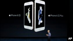 Apple CEO Tim Cook discusses the new iPhone 6s and iPhone 6s Plus during the Apple event at the Bill Graham Civic Auditorium in San Francisco, Sept. 9, 2015.