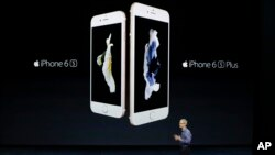 Apple CEO Tim Cook discusses the new iPhone 6s and iPhone 6s Plus during the Apple event at the Bill Graham Civic Auditorium in San Francisco, Wednesday, Sept. 9, 2015. (AP Photo/Eric Risberg)