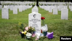 The grave of Army Captain Humayun Khan is seen adorned with flowers at Arlington National Cemetery in Arlington, Virginia, Aug. 1, 2016.
