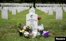 The grave of Army Captain Humayun Khan lies at Arlington National Cemetery in Arlington, Virginia, U.S., August 1, 2016.