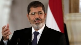 FILE - Egyptian President Mohammed Morsi speaks to reporters at the Presidential palace in Cairo, July 13, 2012.