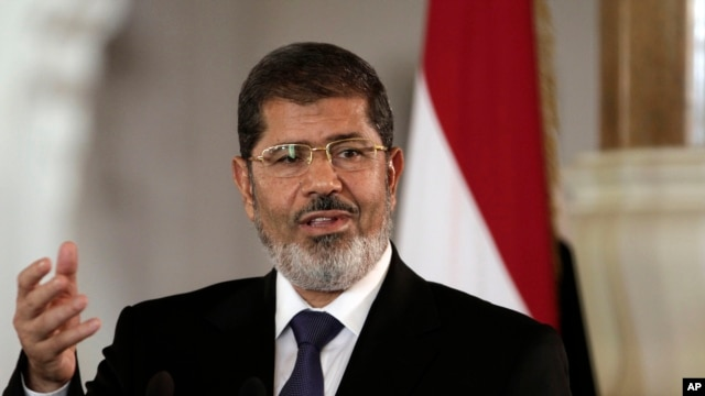 Egyptian President Mohammed Morsi speaks to reporters at the Presidential palace in Cairo in this July 13, 2012 file photo.