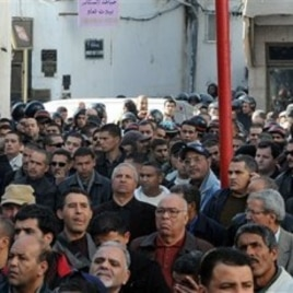 People are seen during a demonstration in Tunis, Tunisia, against high prices and unemployment, 08 Jan 2011.