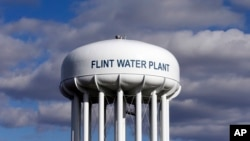FILE - The Flint Water Plant water tower is seen in Flint, Michigan, March 21, 2016.