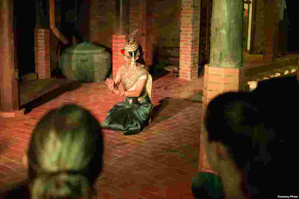 Apsara dancer Choung Veasna performs in a traditional 100-year-old Khmer house owned by art historian Darryl Collins, Siem Reap, Cambodia, July 14, 2017. (Photo: Enric Contreras)