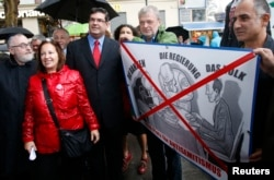 FILE - Rabbi Paul Chaim Eisenberg, left, and Oskar Deutsch, president of the Jewish Community of Vienna, third from left, participate in a protest against anti-Semitism in Vienna, Sept. 12, 2012.