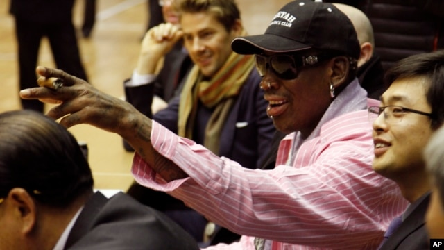 Former NBA basketball star Dennis Rodman and an interpreter look on during a basketball practice session in Pyongyang, North Korea on Friday, Dec. 20, 2013.