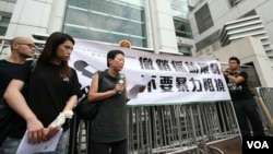 FILE - Hong Kong journalists protest suppression by mainland authorities in 2012.