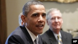 Senate Minority Leader Mitch McConnell of Ky. looks on at right, as President Barack Obama meets with Congressional leaders regarding the debt ceiling, Wednesday, July 13, 2011, in the White House in Washington.