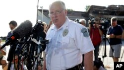 FILE - Ferguson Police Chief Thomas Jackson releases the name of Officer Darren Wilson, who fatally shot Michael Brown, an unarmed black teenager, Aug. 15, 2014.
