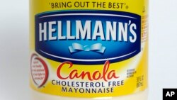 "FILE - This Monday, Nov. 17, 2014, file photo, shows a jar of Hellmann's ""Canola Cholesterol Free Mayonnaise,"" in Walpole, Mass."