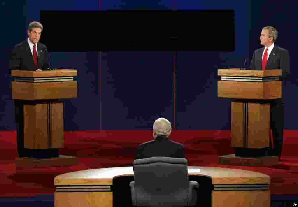 Democratic presidential candidate Sen. John Kerry answers a question as President Bush listens during the presidential debate in Tempe, Arizona, Oct. 13, 2004.