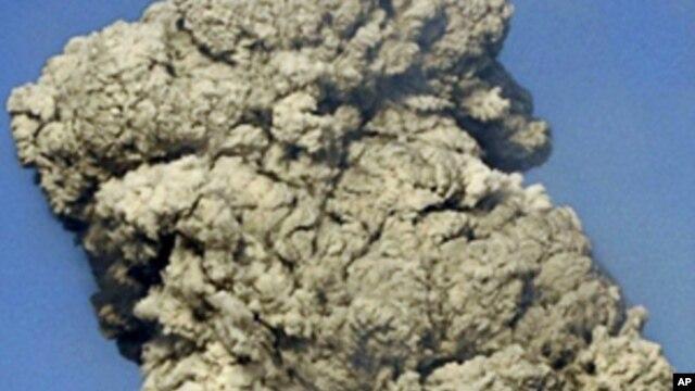 FILE - White smoke raises from Mount Shinmoedake in Kirishima mountain range in Kagoshima prefecture, Japan's southern island of Kyushu.