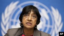 U.N. High Commissioner for Human Rights Navi Pillay addresses a news conference on the situation in Tunisia at the European headquarters of the United Nations in Geneva, January 19, 2011