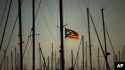 FILE - A Catalonia independence flag waves on a mast of a boat at the port of Vilanova i La Geltru, Spain, Oct. 31, 2017.