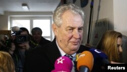 FILE - Milos Zeman, shown talking to reporters in Prague in January 2013, has repeatedly criticized sanctions against Moscow imposed by the West in response to the annexation of Crimea and the conflict in eastern Ukraine.