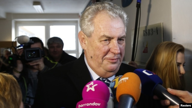 Milos Zeman talks to media after casting his vote in presidential elections at a polling station in Prague, Jan. 11, 2013.