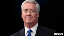 FILE - Britain's Defense Secretary Michael Fallon arrives to address the Conservative Party Conference in Manchester, Britain, Oct. 4, 2015.