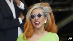 In this May 16, 2012, file photo, Lady Gaga arrives at the Sungshan airport in Taipei, Taiwan.