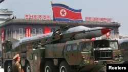 FILE - A North Korean missile is carried by a military vehicle during a parade in Pyongyang.