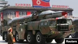 FILE - A missile is carried by a military vehicle during a parade in Pyongyang July 27, 2013.