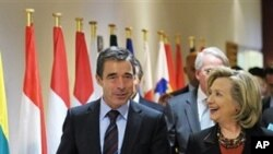 US Secretary of State Hillary Rodham Clinton, right, walks with NATO Secretary-General Anders Fogh Rasmussen after a NATO meeting, Thursday Oct. 14, 2010 at NATO headquarters in Brussels. Clinton arrived in Brussels following a two-day tour of the Balkans