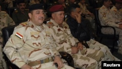 Commander of the army's Seventh Division, Maj. Gen Mohammed Ahmed al-Kurwi, left, attends Ministry of Defence conference, Baghdad Dec. 14, 2013.