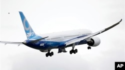 The Boeing 787-9 in flight, Tuesday, Sept. 17, 2013, at Paine Field in Everett, Washington.