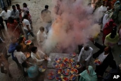 FILE - Pakistani Hindus celebrate Holi, festival of colors in Lahore, Pakistan, March 8, 2012.