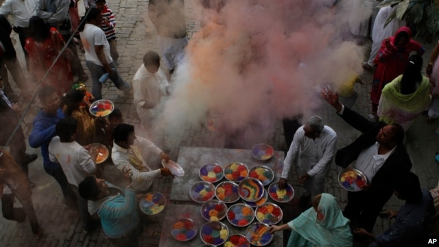Pakistani Hindus celebrate Holi, festival of colors in Lahore, Pakistan, in 2012. The Hindus who got alcohol poisoning consumed the hooch during preparations for Holi celebrations, which will begin Wednesday.
