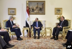 Egypt's President Abdel-Fattah el-Sissi (C) and his Foreign Minister Sameh Shoukry (R) listen to U.S. Secretary of State John Kerry speaking before their talks at the presidential palace in Cairo Aug. 2, 2015.