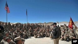 US Defense Secretary Robert Gates speaks to US Marines during his visit to the 3rd Battalion, 5th Marine Regiment at Forward Operating Base Sabit Qadam in Afghanistan's Helmand province, March 8, 2011