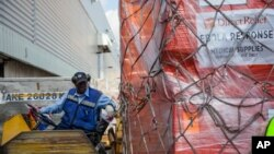 Offloading Ebola relief supplies from Direct Relief to aid in response efforts. (PRNewsFoto/Direct Relief)