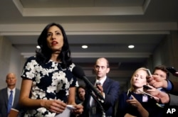 FILE - Huma Abedin, a longtime aide to Hillary Rodham Clinton, speaks to the media after testifying at a closed-door hearing of the House Benghazi Committee, on Capitol Hill, Oct. 16, 2015 in Washington.