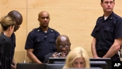 Former Ivory Coast President Laurent Gbagbo, back row center, attends confirmation of charges hearing, International Criminal Court, The Hague, Netherlands, Feb. 19, 2013.