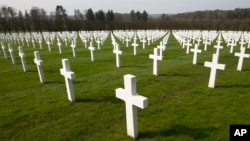 FILE - A view of the rows of crosses of American World War I soldiers at the Meuse-Argonne American cemetery in Romagne-sous-Montfaucon, March 24, 2017. It was America's largest and deadliest battle, with 26,000 U.S. soldiers killed and tens of thousands wounded.